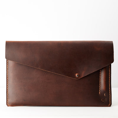 Closed. Tan leather sleeve for Pixel Slate. Mens gifts