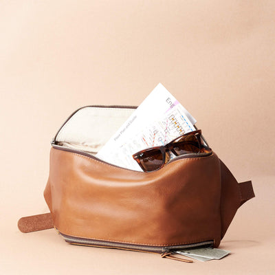 Tan Fenek sling bag backpack made by Capra Leather. Styling of over the shoulder bag in use.