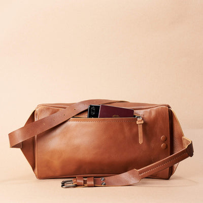 Tan Fenek sling bag backpack made by Capra Leather. Styling back pocket of small  leather crossbody for easy access.