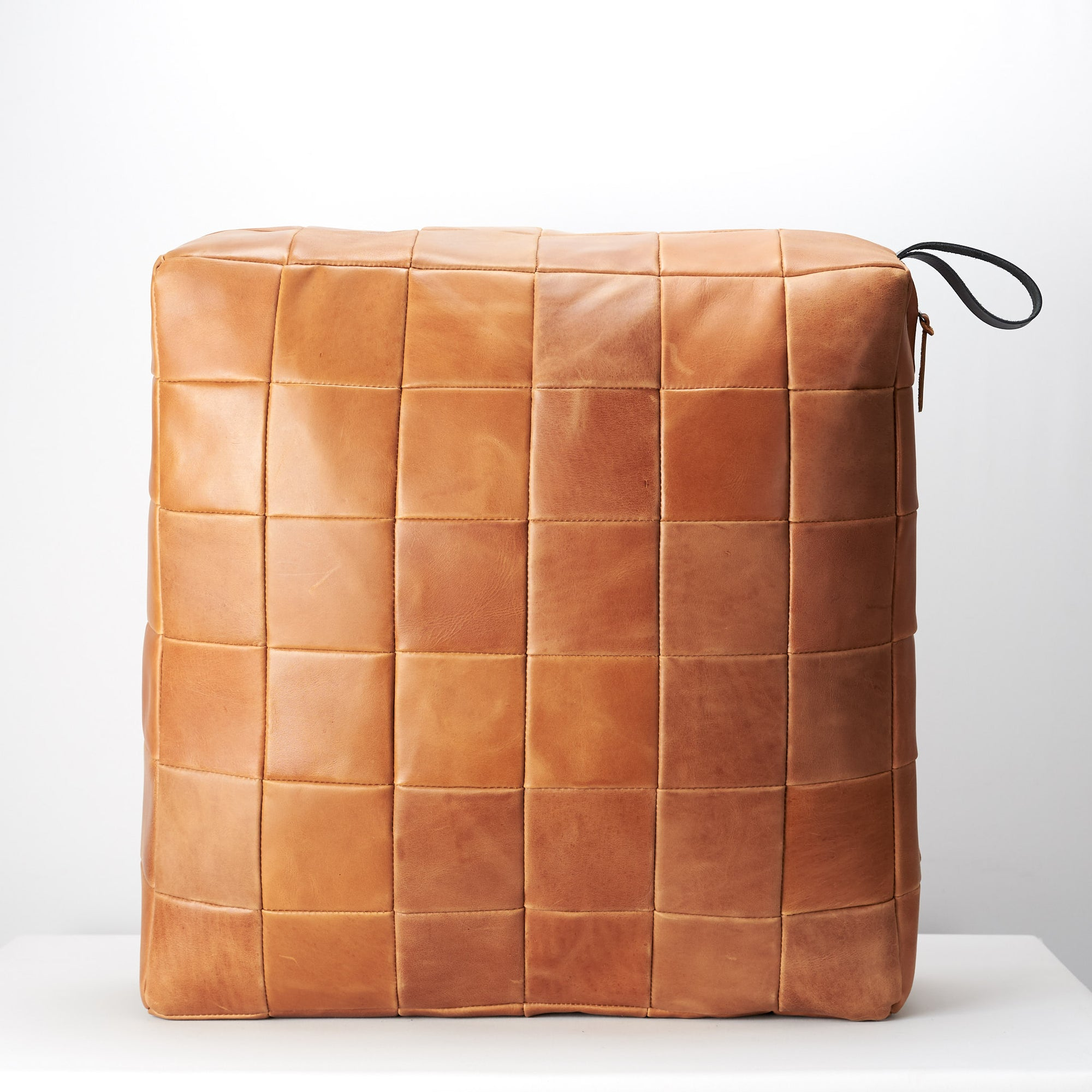 Tan Leather floor cushion pillow for indoors decoration.