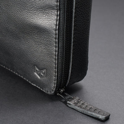 Metallic YKK zippers. Men's handmade black tech laptop tablet bag for travelers.