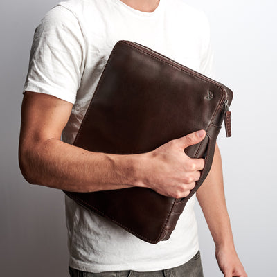 Optional handle. Men's handmade black tech laptop tablet bag for travelers.