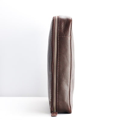 Slim profile.  Handmade dark brown tech laptop 15 inch tablet bag is perfect for a business travel.