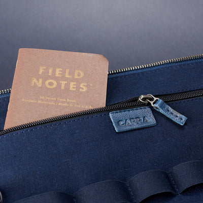 Linen pocket detail .handmade blue leather tech laptop tablet bag is perfect to travel organized.