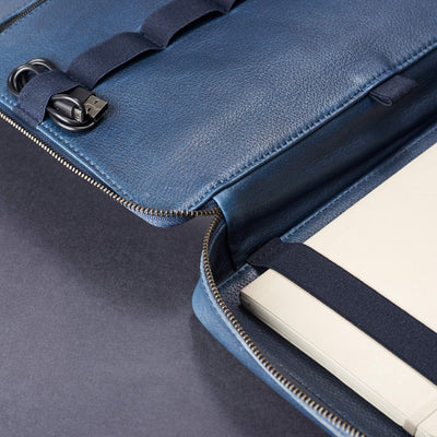 Leather interior detail. Men's handmade blue leather 15 inch tech laptop tablet bag is perfect to travel organized.