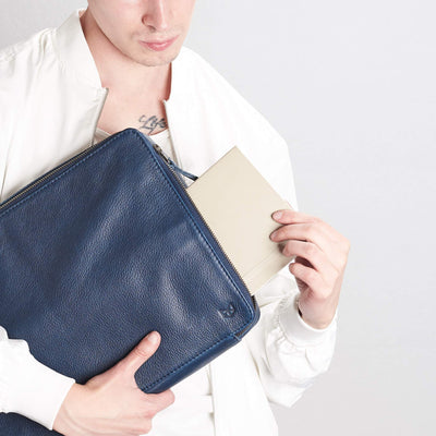 Style book inside tech bag. Men's handmade blue leather 15 inch tech laptop tablet bag is perfect to travel organized.