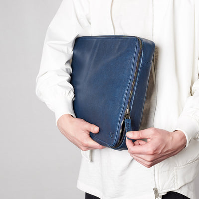 Zipper in use .handmade blue leather tech laptop tablet bag is perfect to travel organized.