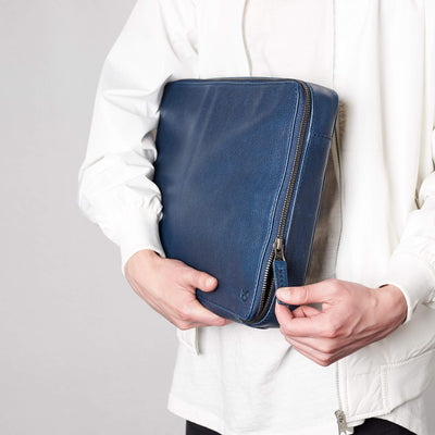 Zipper style detail. Men's handmade blue leather 15 inch tech laptop tablet bag is perfect to travel organized.