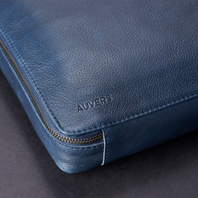Engraving detail. Men's handmade blue leather 15 inch tech laptop tablet bag is perfect to travel organized.