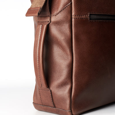 Detail brown handmade leather messenger bag for men. Commuter bag, laptop leather bag by Capra Leather.