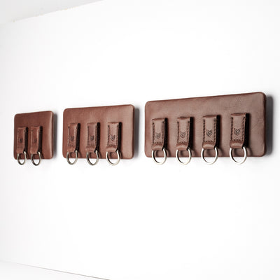 different sizes. Magnetic key hanger organizer. Brown leather magnetic key holder for wall decor. Entryway organizer decor. Home decoration. Keys organizer