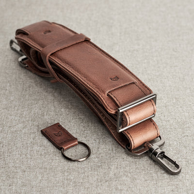 Shoulder strap and key chain holder detail. Brown leather workbag. Mens handmade satchel