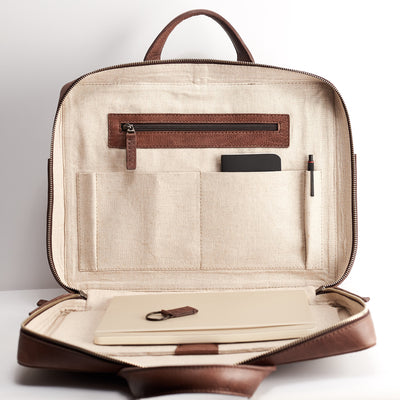 Interior pocket detail. Brown leather briefcase for men. Minimalist designer workbag