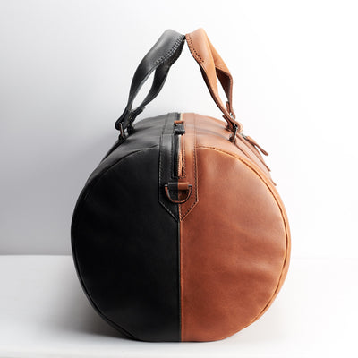 Double color. Double color men's duffle bag. Limited edition designer product. Unique weekender for travel.