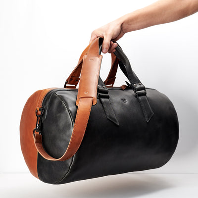 Style. Double color men's duffle bag. Limited edition designer product. Unique weekender for travel.