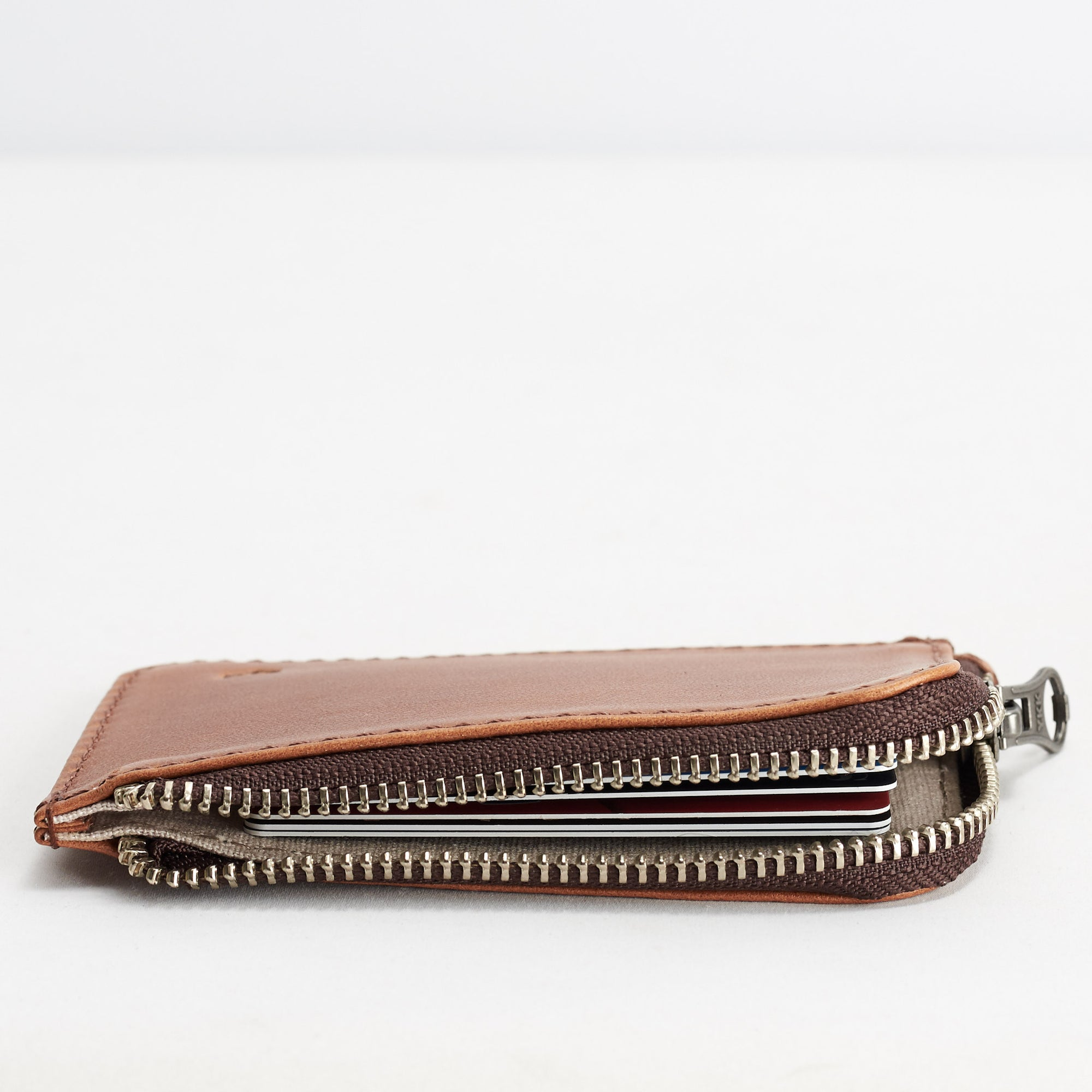Cover. Minimalist tan zipper card holder. Men's bills and coins wallet. Slim designer credit cards holder
