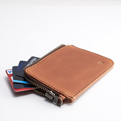 Style. Cover. Minimalist tan zipper card holder. Men's bills and coins wallet. Slim designer credit cards holder