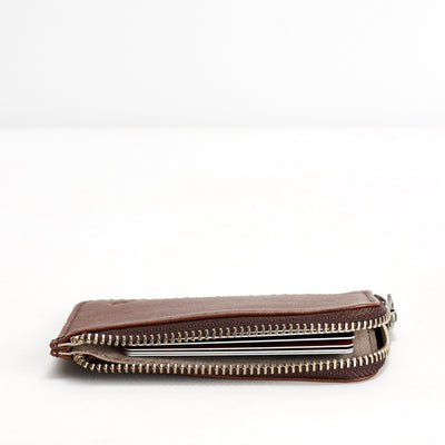 Slim profile. Minimalist brown zipper card holder. Men's bills and coins wallet. Slim designer credit cards holder