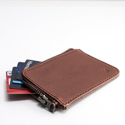 Style. Minimalist brown zipper card holder. Men's bills and coins wallet. Slim designer credit cards holder