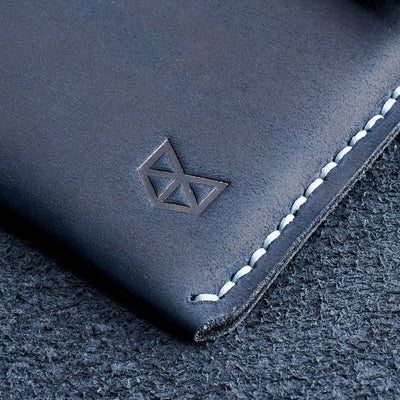Capra logo detail. Blue handcrafted leather reMarkable tablet case. Folio with Marker holder