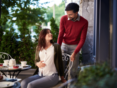 man pulling out chair for woman