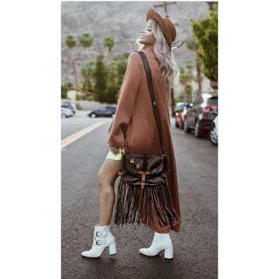 Cara Loren with a preowned Louis Vuitton purse that has a fringed customization by New Vintage Handbags.