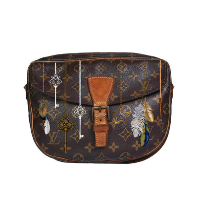 Customized, preowned Louis Vuitton purse with boho style hand painted artwork painted by a New Vintage Handbags artist.