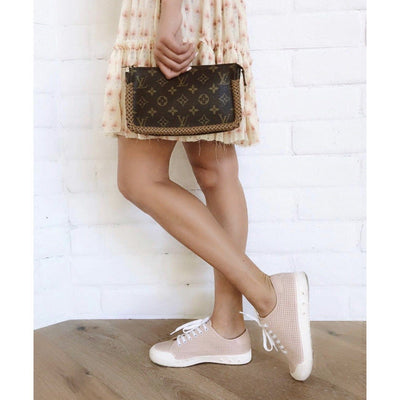 Girl standing with customized Louis Vuitton that has needlework braided around the edges by New Vintage Handbags
