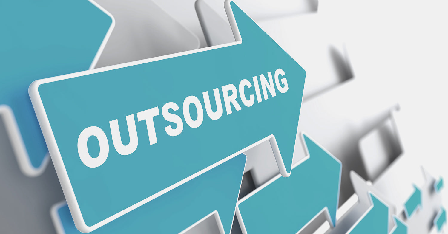 """An arrow showing the words """"outsourcing"""" to reflect outsourcing services"""