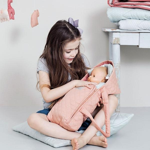 Girl Playing with a doll | Cam Cam Dolls Carry Cot in Dusty Rose