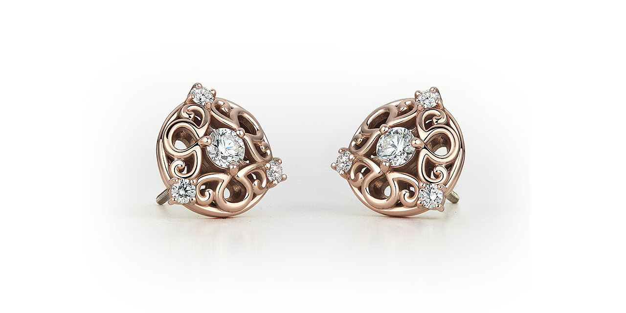 Rose gold and diamond bridal stud earrings, featuring an a/g initials symbol that creates a unique filigree pattern.
