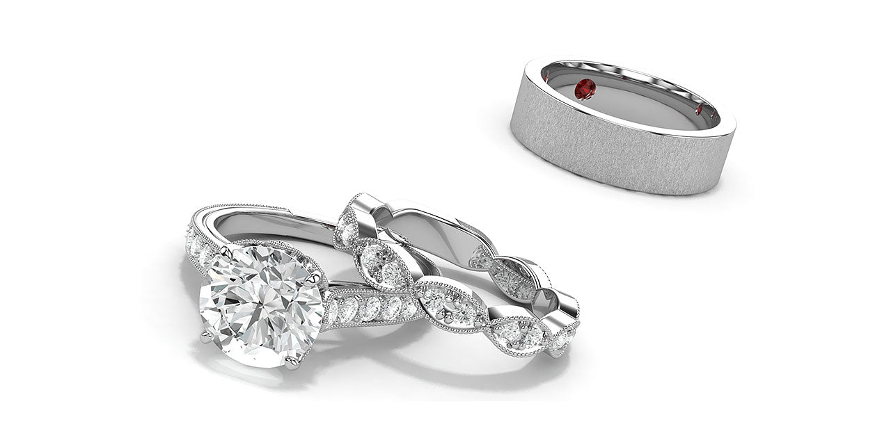 A platinum and diamond engagement ring and wedding band using lotus flower petal shapes and hidden birthstones.