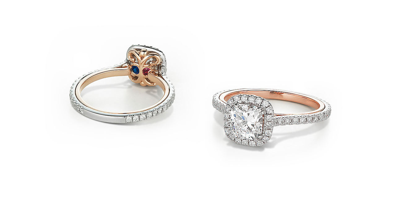 Photographs of the top and underside of an open scroll two-tone engagement ring set with diamonds and birthstones.