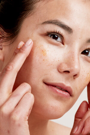 Rosehip Bioregenerate Oil being applied to face