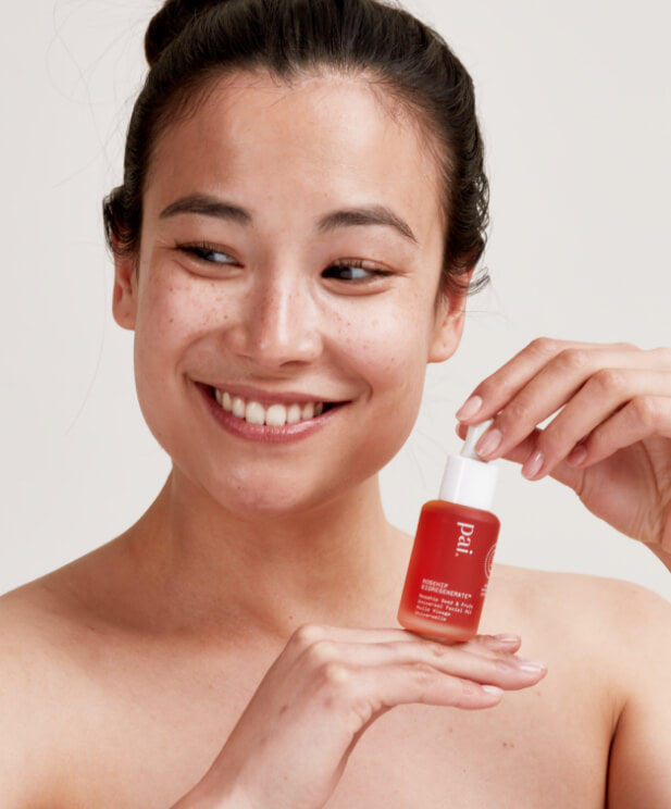 woman holding rosehip oil
