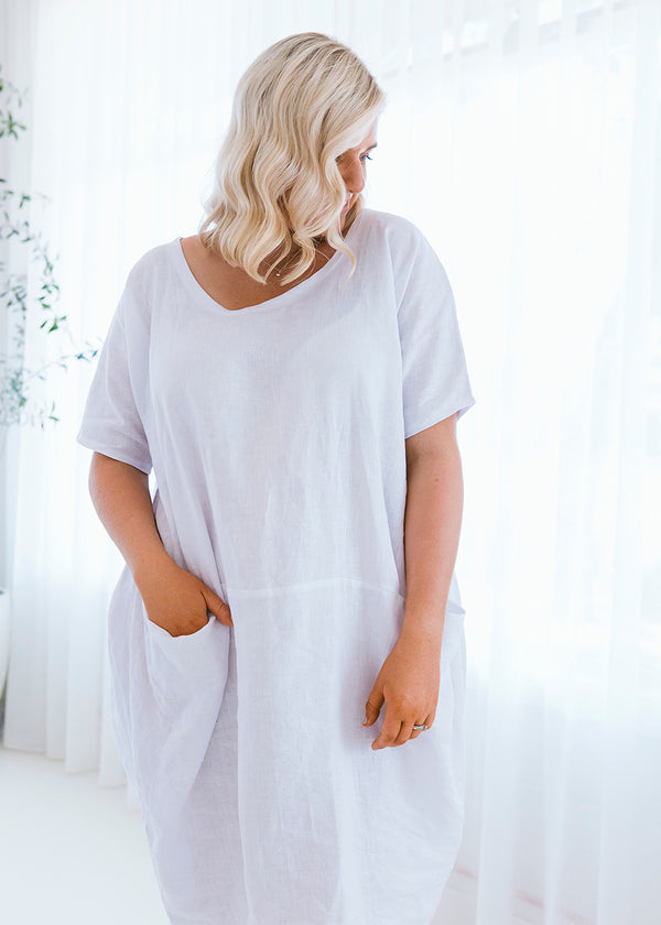salt and soda australian owned womens fashion label comfortable relaxed fit round neck white linen dress with pocket detail