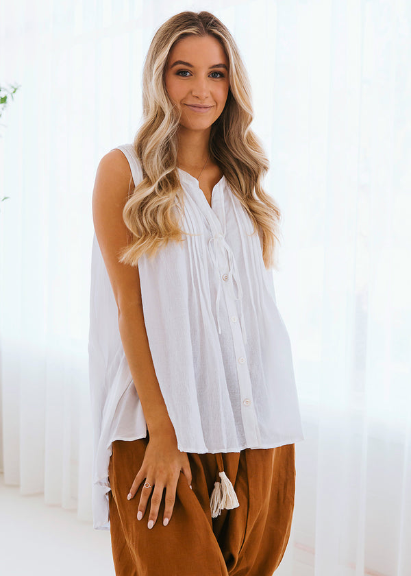 Salt & Soda Design For Everybody For Every Season For Every Day Amalfi Blouse Crisp White Classic Sleeveless Shirt Button Feature Free Flowing Feminine Draped Back Hemline Pleat Feature Front With Tie