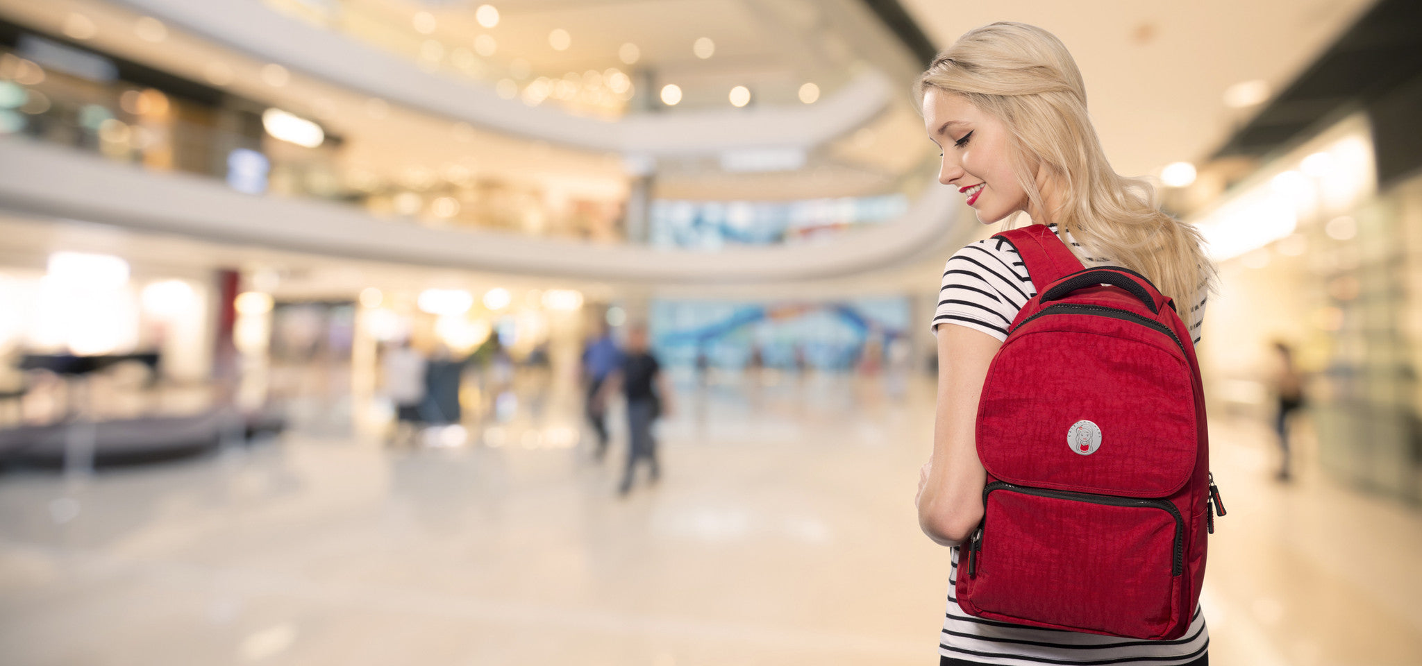Girl carrying a Cristina Girl bag in red colour