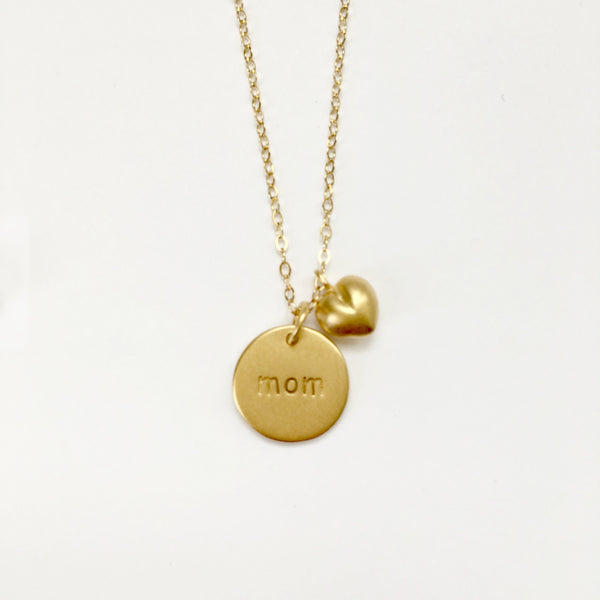 Gold 'mom' stamped disc necklace with puff heart