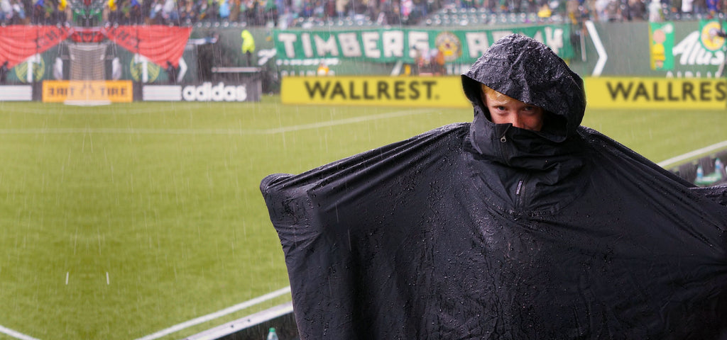 Happy Portland Timbers fan watching a Timber's match while wearing a Wallrest