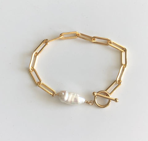 Gold elongated chain, pearl & toggle bracelet