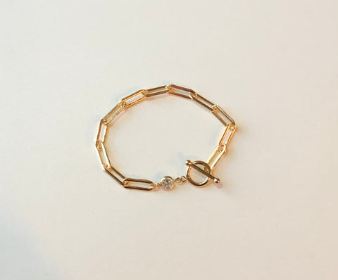 Gold elongated chain bracelet with toggle