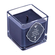 Luxurious black highly scented tuberose and ginger soy wax candle in a cubed glass container