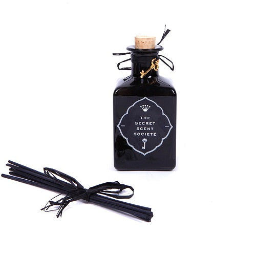 Peach black glass reed diffuser bottle with black reeds