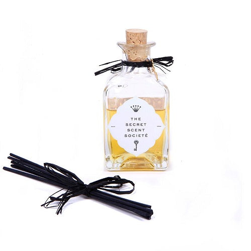 Coconut and mediterranean fig glass reed diffuser bottle with black reeds