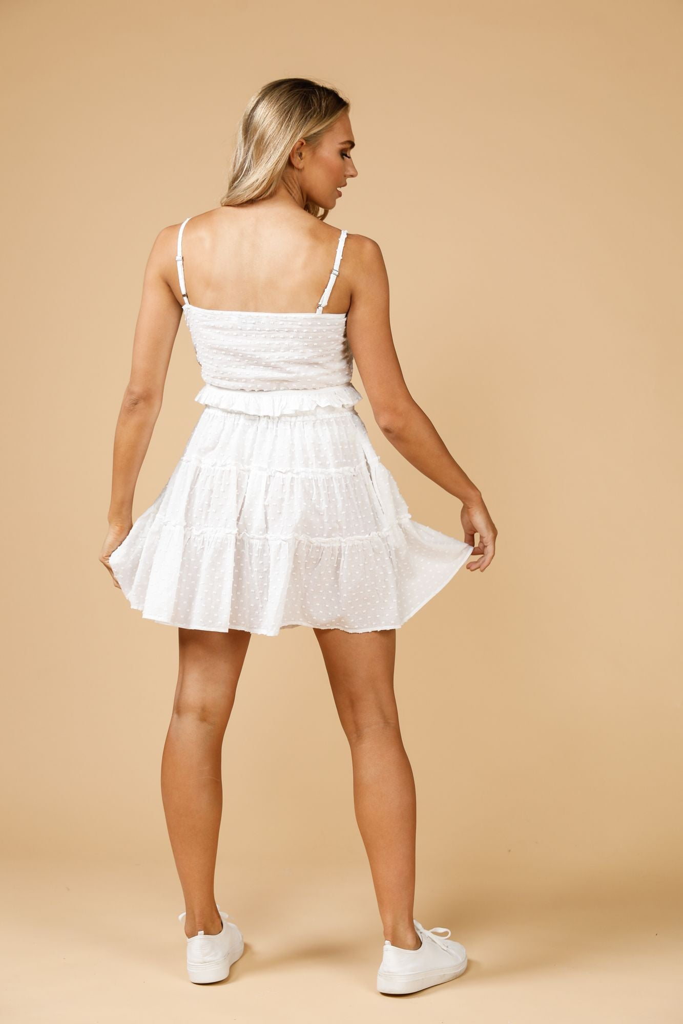 White Dobby Piper Mini Skirt - by Daisy Says currently available from Rawspice Boutique.