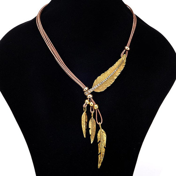 Gold Feather on Leather Strap