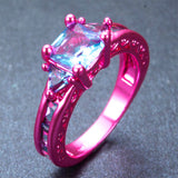 Hot Pink Gold With A Pale Blue Emerald Cut Blue Cubic Zirconia