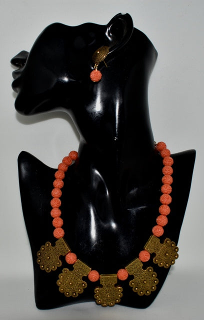 Tribal design charm necklace with carved synthetic coral beads and matching earring