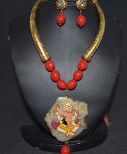 Handpainted gemstone pendant with coral beads